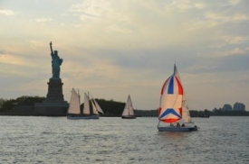 sailing in front of the Statue of Liberty